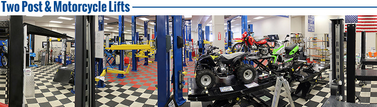 Our tire changer area in our showroom displays a variety of tire changers. Also shown in picture are our folding engine crane, parts washer, motorcycle lifts, and transmission jacks.